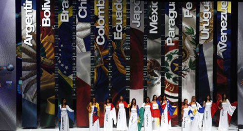 Models hold the flags of the countries participaiting in the Cop
