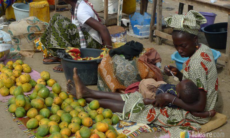 Vendedora de mangos por la mañana
